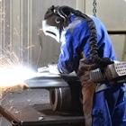 Worker welding in full safety gear