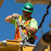 Construction worker working at elevated heights wearing safety grear