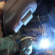 Welder using MIG equipment