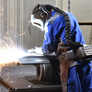 Worker welding in full safety gear