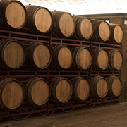 A row of aging wine barrels