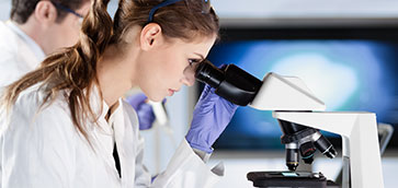 picture of researcher looking in microscope