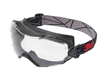 A pair of 3M safety googles against white.