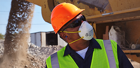 A 3M user utilizes a 3M respiratory mask on a construction site