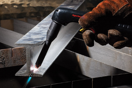 A Powermax user extends the plasma cutter's reach with HyAccess consumables to more easily perform the desired cut on an I-beam. Photo courtesy of Hypertherm.