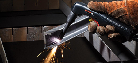 A Hypertherm user utilizes an extended consumable for a hard-to-reach cut.
