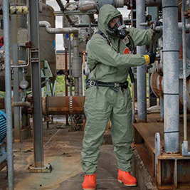 Refinery workers wear green Tychem 2000 SFR flame resistant-disposable hooded protective coveralls