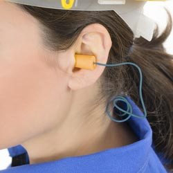 Female construction worker wearing Earplugs
