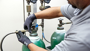 Using gas handling equipment and accessories, an Airgas Healthcare technician safely installs cylinders at the point of use in a healthcare facility.