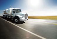 An Airgas truck drives down a road.