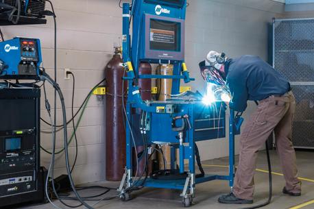 picture of welder practicing in Miller classroom