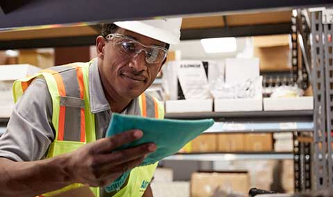 An Airgas Supply Chain technician reviews an order form.