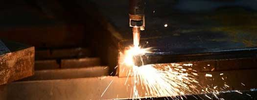 Cutting torch cutting steel beams