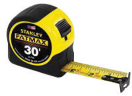 A stanley tape measure over a solid white background.