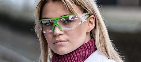 A female worker wears 3M eye protection.