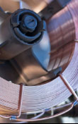 Close-up shot of a spool of MIG welding wire.