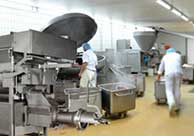 Bottom Injection article Food manufacturing floor featuring food-freezing equipment utilizing bottom injection.
