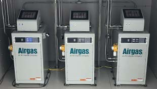 A row of three Airgas gas mixers.